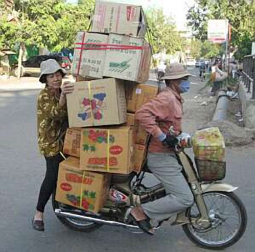 Asian Motorcycle Carrying Cargo