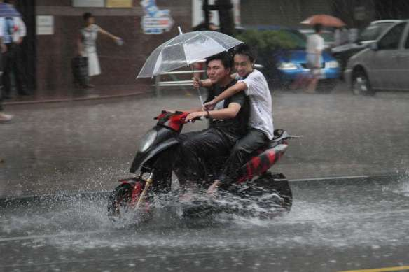 Image result for riding a motorcycle in the rain